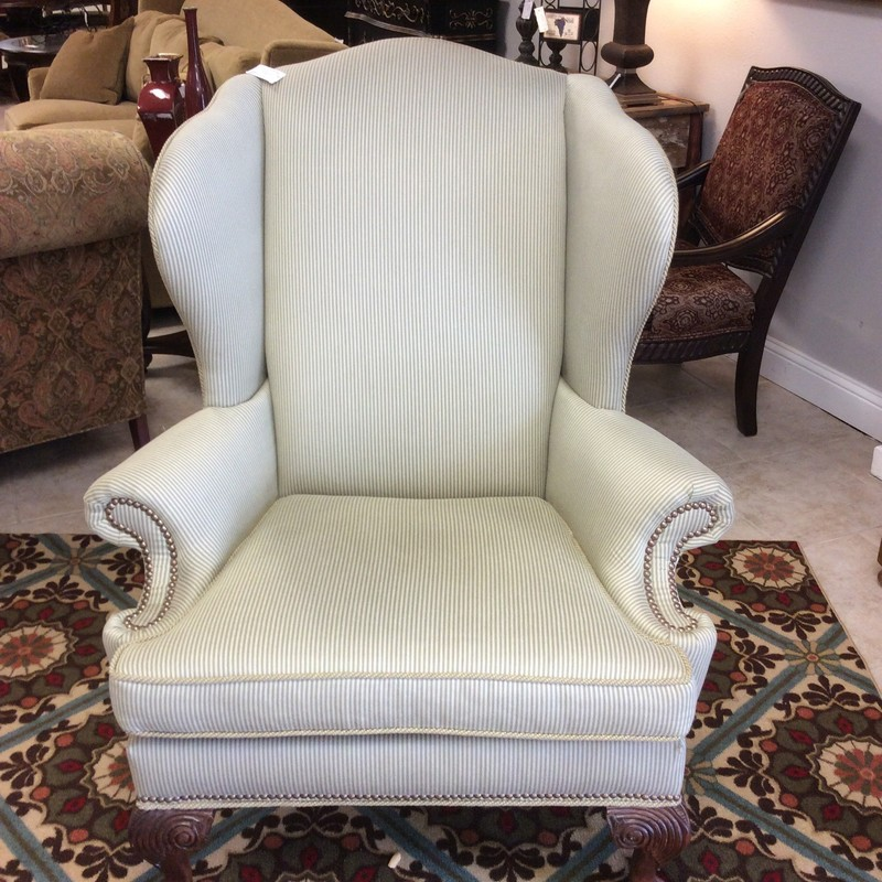 This handsome oversized ETHAN ALLEN wingback chair is in great condition! The removable seat cushion is quite firm, and the striped olive and beige upholstery is soft and cozy. There are also removable arm covers and hundreds of smart looking brass nailhead accents.