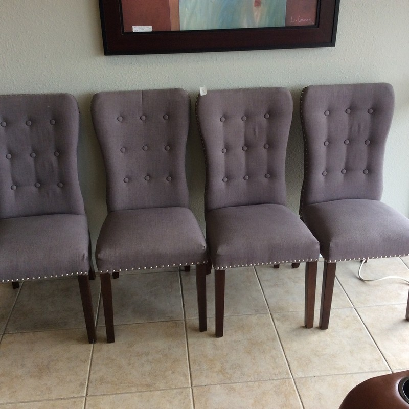 This is a really pretty little set of chairs. They are upholstered in a taupe colored, linen like fabric, and have literally hundreds of shiny silver nailhead accents. The seat backs are each tufted with 9 self-covered buttons.