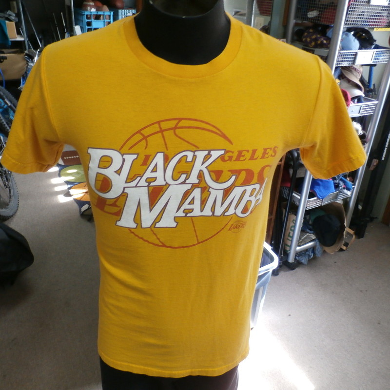 "L.A. Lakers Kobe Bryant ""Black Mamba"" Majestic Tee Yellow Size Small #17034<br /> Rating: (see below) 3- Good Condition<br /> Team: LA Lakers<br /> Player: Kobe Bryant<br /> Brand: Majestic<br /> Size: Men's Small- (Measured Flat: Across chest 18""; Length 26"")<br /> Measured Flat: underarm to underarm; top of shoulder to bottom hem<br /> Color: yellow<br /> Style: short sleeve; screen printed<br /> Material: 100% cotton<br /> Condition: 3- Good Condition: minor wear and discoloration from use (see photos) (see photos)<br /> Item #: 17034<br /> Shipping: FREE"