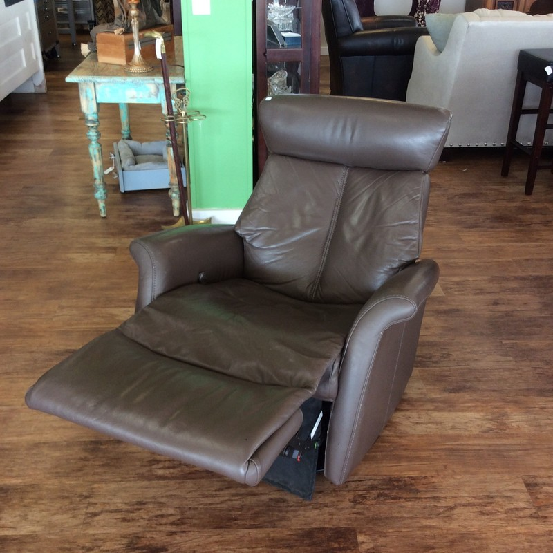 WE LOVE THIS CHAIR! Not only is it comfortable, but the sleek SCANDANAVIAN design is gorgeous. The footrest is manually elevated with  handle tucked inside the right are. The headreast also features dual manual adjustability. It's a great deal at only $495!