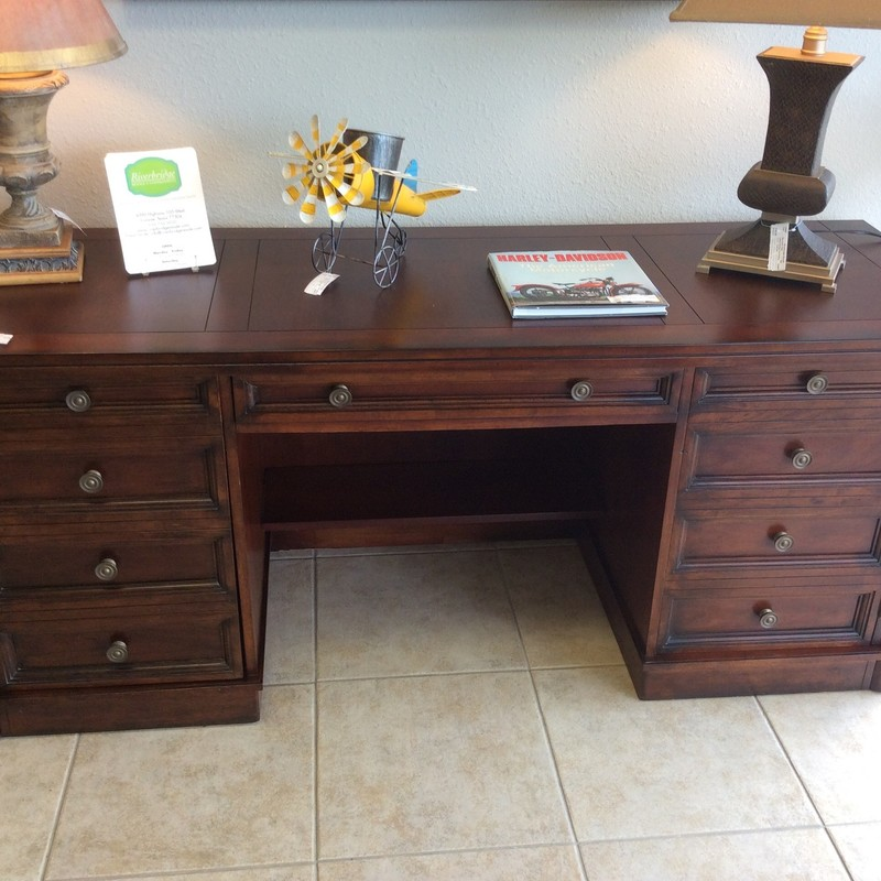 This handsome HOOKER credenza/desk is from their SEVEN SEAS COLLECTION. The front of the center drawer drops down for a keyboard. All of the other drawers are just a facade, as the panels actually swing all the way open to reveal lots of inner storage space.