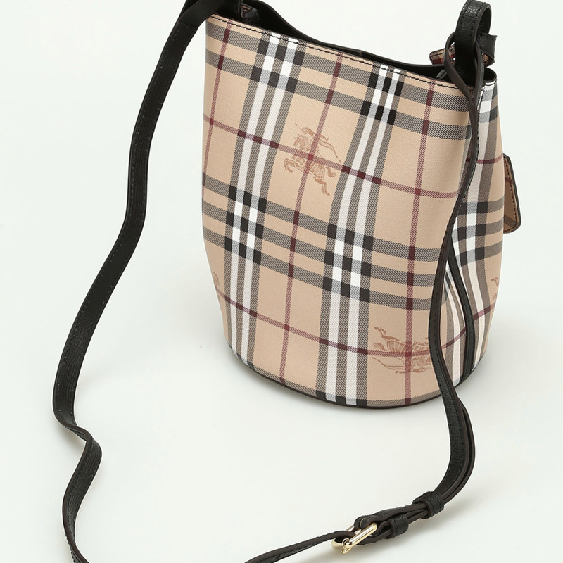 "Burberry Lorne Bucket Bag, Black, Size: Small<br /> Black textured leather Burberry Small Lorne bucket bag with gold-tone hardware, adjustable flat shoulder strap, tan and multicolor Haymarket coated canvas lining and magnetic closure at top. Includes Dustbag. Excellent condition. Shoulder Strap Drop Max: 21""<br /> Shoulder Strap Drop Min: 19""<br /> Height: 9""<br /> Width: 7""<br /> Depth: 6"""