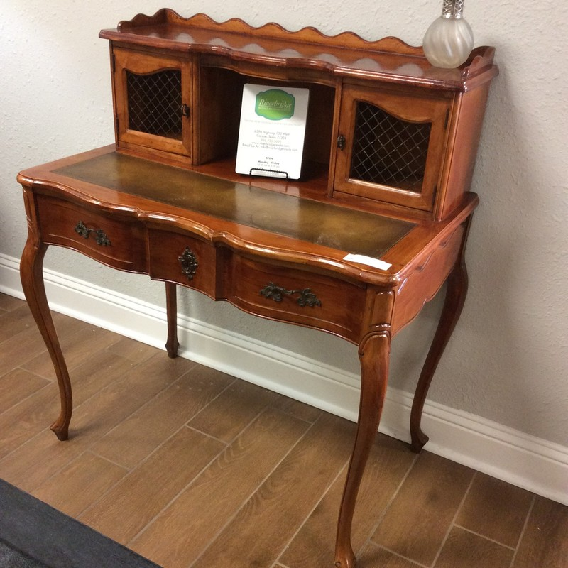 This sweet, small desk would be perfect for a hallway, a little niche, a small study or bedroom. Vintagy in style, it reflects an attention to craftsmanship and detail that you don't see as much these days. This desk features a leather inlay, a large drawer with dovetail jointing and 3 cubbies for storage. It's a charming piece!