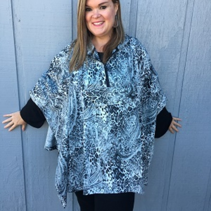"Tonya looks stunning in our Simply Noelle Rain Poncho. You can stay cute and comfy even on those rainy days. Lightweight Water Resistant Material, Half Zip Front, Hood, Poncho Folds into Front Pocket to make a Wristlet Carrying Pouch.<br /> 100% Polyester<br /> 30"" Long"