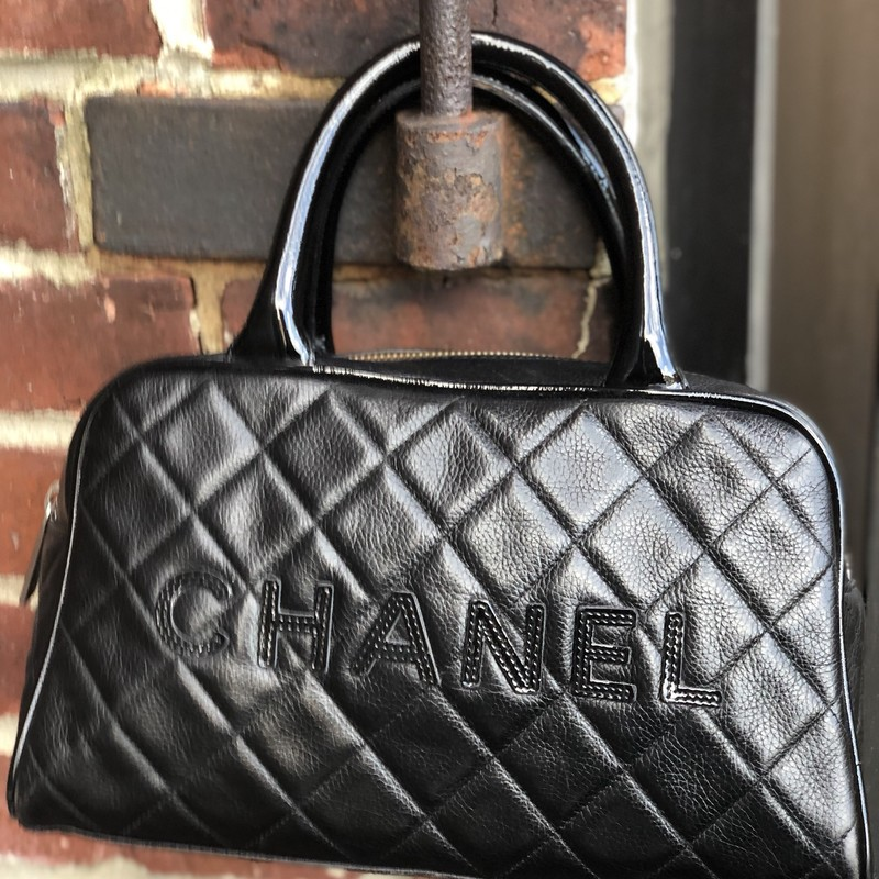 "Chanel Bowling Bag, Black, Size: Medium<br /> Gorgeous and Rare Chanel Bowler, Resale on this bag is up to $2500 used.<br /> Outside is in very good condition. Inside shows some fading and inside pocket zipper pull is missing.<br /> Includes Dustag.<br /> Measures 10.5"" wide, 6"" tall, 3 1/4"" deep!"