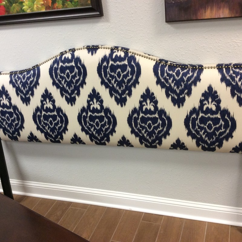 Wow, this POTTERY BARN piece is gorgeous! It does not come with a footboard or a frame, but if you just need a headboard, maybe this will work for you. The pretty royal blue, navy blue and cream colored upholstery is in excellent condition. The hundreds of nailhead accents are a pretty burnished brass.