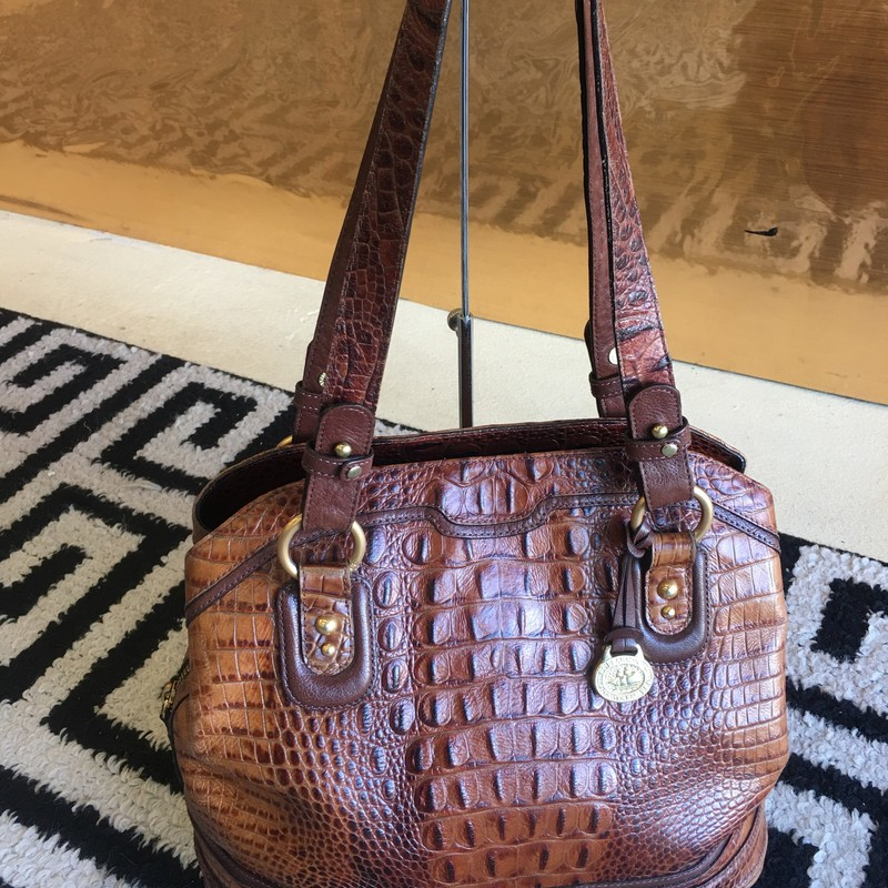 Used Brahmin handbag. Walnut brown leather with chestnut brown handles and gold hardware. Beige interior. Some signs of use. Wear around corners and handles, and pen marks and staning on interior fabric. Overall, still a great, quality bag. DON'T MISS OUT!