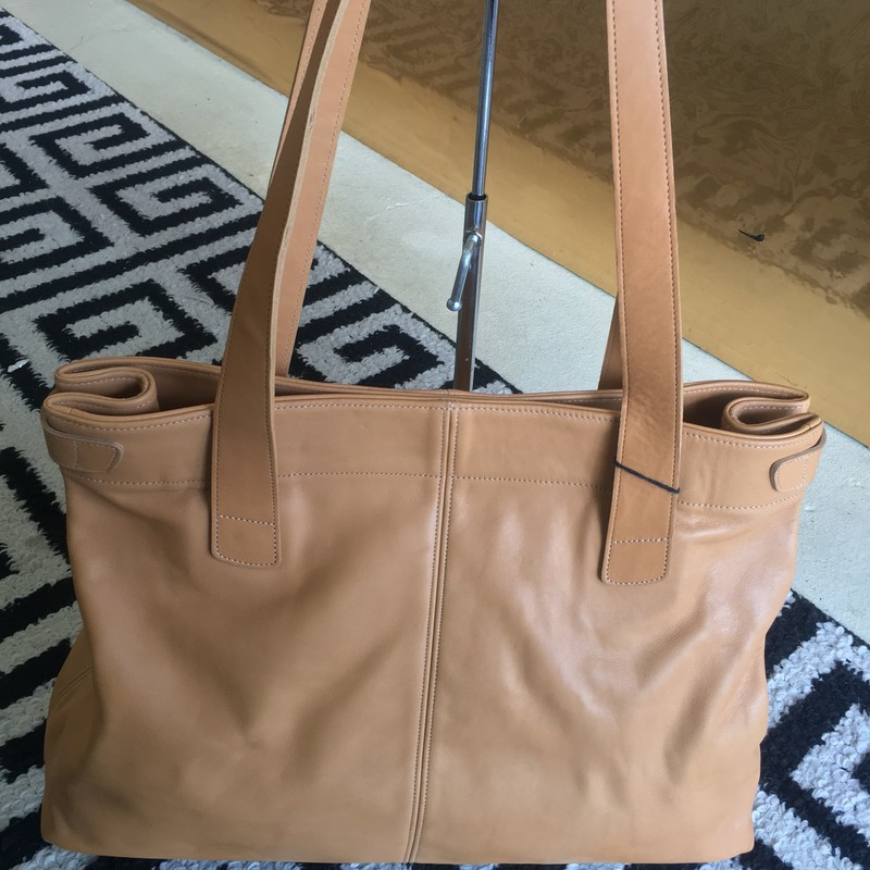 GORGEOUS Coach tote bag. Tan, all leather interior and exterior. Like new, zero signs of use. No scuffs, rips, or staining. Looks like it just came from the Coach factory! Retail appox: $785. WON'T LAST!