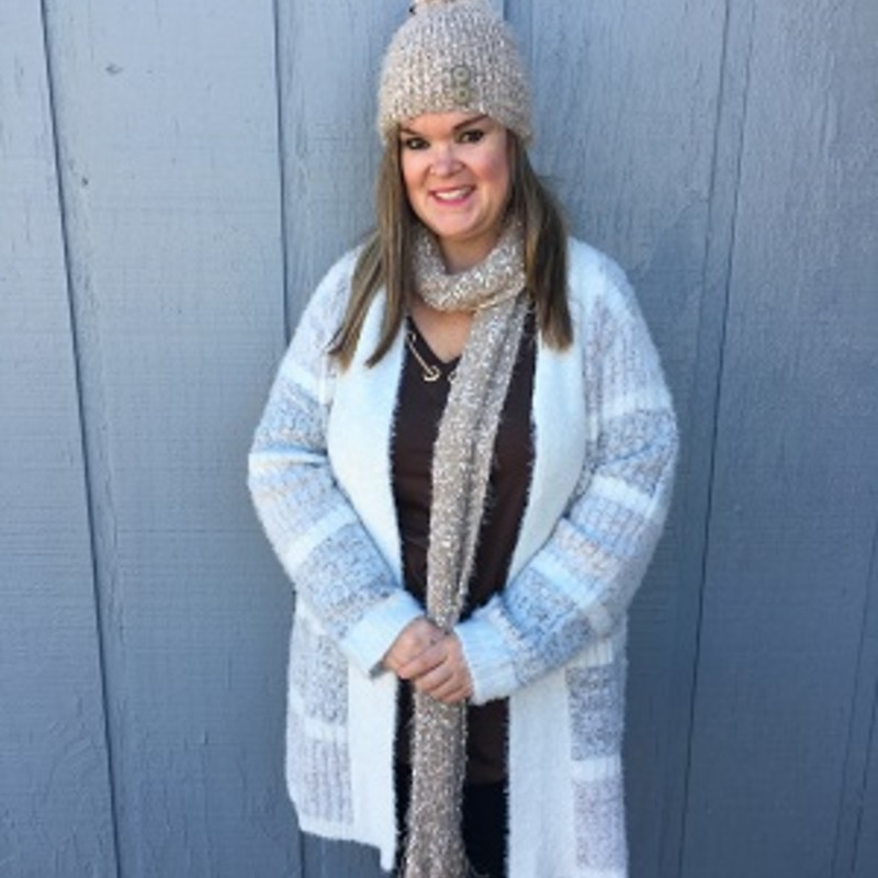 "Tonya looks stunning in our Simply Noelle Feather Weather Cardigan. It goes great with our Simply Noelle Hat and Scarf (sold separately). Soft Feather Knit, Horizontal Stripe Pattern, Solid Lapel.<br /> 66% Polyester 34% Acrylic<br /> 37"" Long"