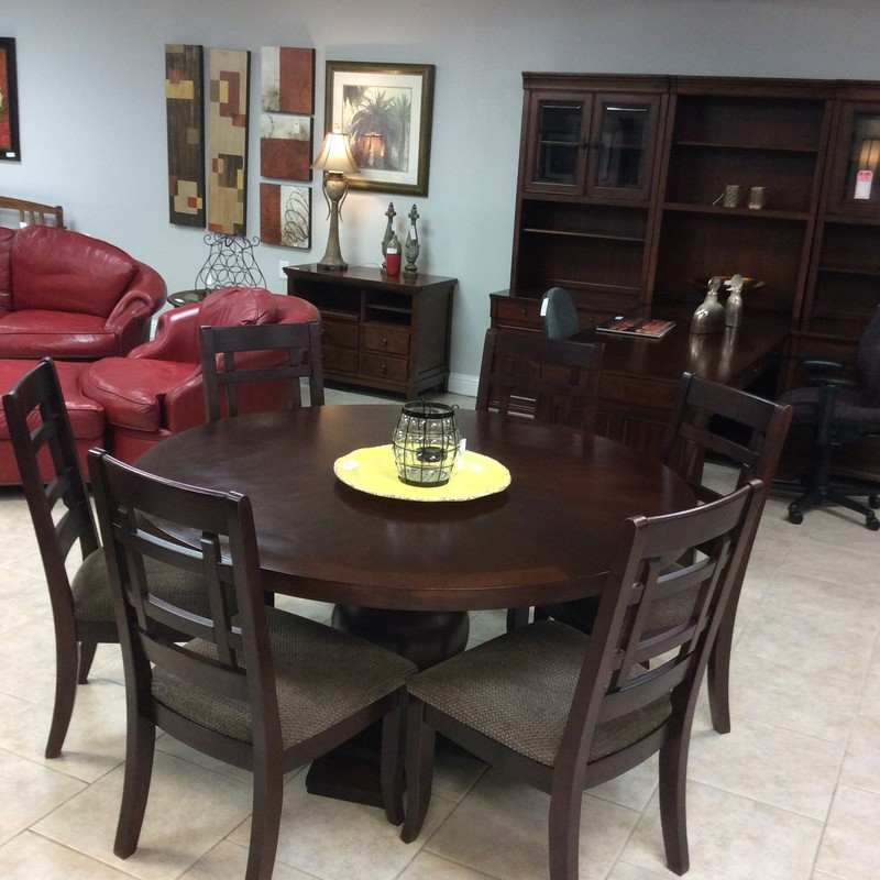 "This dining room set from Z Gallerie would be perfect for the upcoming holidays!  At 60"" in diameter, it's large with a rich, dark wood finish. It sits atop a GRAND  pedestal base that is an eye-catcher indeed!  Six chairs are included that have been upholstered in a taupy brown soft cotton blend. The style is modern but neutral and classic enough to be used with many decorative styles."