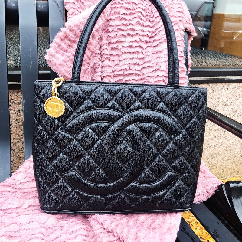 "Chanel Medallion Tote, Black, Size: Medium<br /> Shoulder Strap Drop: 6.75""<br /> Height: 9.75""<br /> Width: 11.5""<br /> Depth: 5.75""<br /> Very good condition Quilted Caviar Medallion Tote with gold hardware. bottom of bag shows very minor fading. A steal on this hard-to-find bag!"