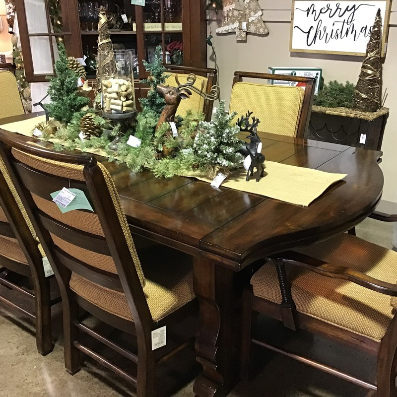 "Comfort and style come together in our Rustic Wood Dining Table & Chair Set. Our long rustic dining table is paired with our six comfortable upholstered chairs in a beautiful shade of neutral gold. The set combines traditional elements such as column table legs with a decorative twisted lower support running the width and the length of the table.  Two 18"" leaves takes the table from 84"" to 120"" for your big family dinners.  Pull out the two endd of the table to fit in the leaves This heirloom quality dining room ensemble will be the center of family celebrations for years to come.<br /> <br /> No Leaves:  84x44x30,<br /> With Leaves:  120x44x30"