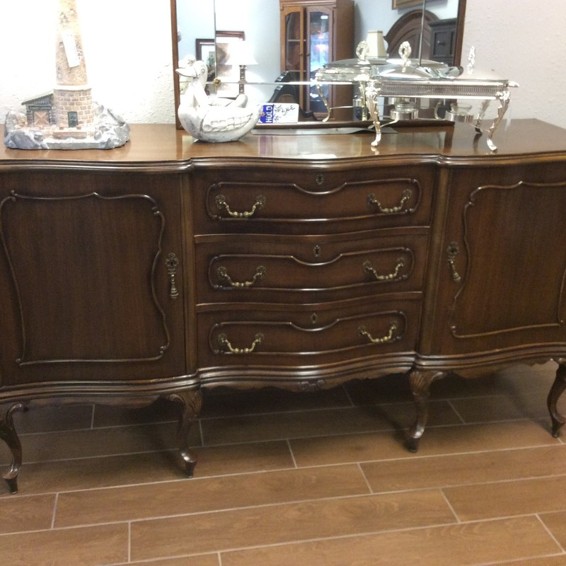BARGAIN ALERT!! We get quite a few unusual vintage buffets ino the store, and this one is no exception. It is solid cherry wood, with a walnut finish. There are 3 roomy drawers, and both cupboards have a single shelf inside. Though it is supposed to be a buffet, this would be gorgeous as an entryway piece or even in the bathroom for linens. Only $695!!!