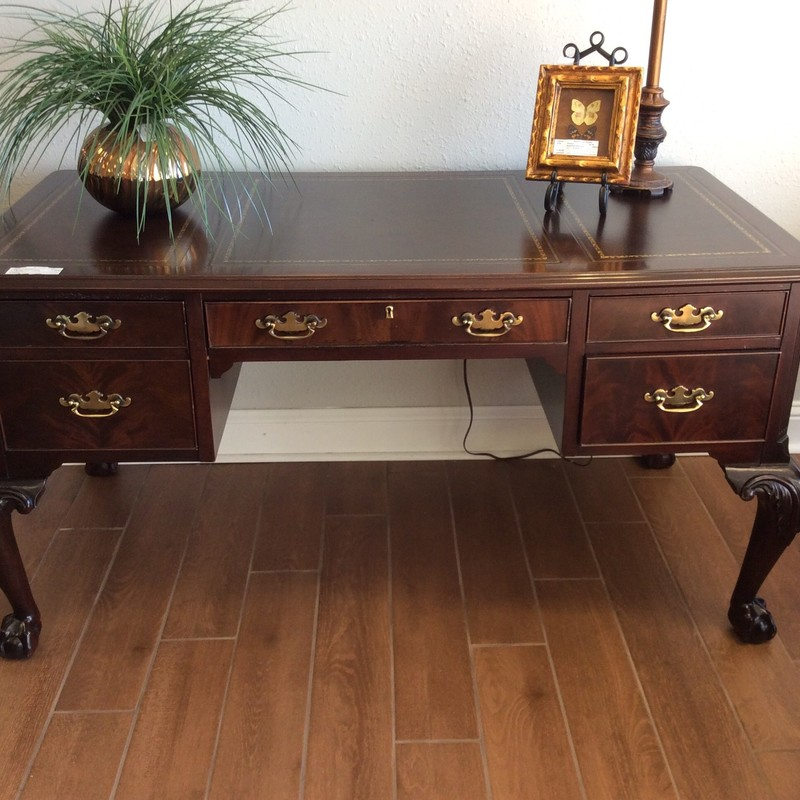 This handsome HEKMAN desk is in fabulous condition. It features solid wood construction, and had brown and gold leather inlays on the top. The carved ball and claw legs are exquisite, and there is a key to lock it all up!