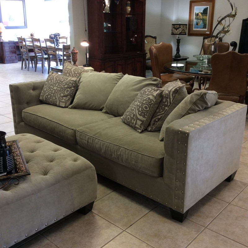 "This super-sized sofa and ottoman set is from the Cindy Crawford Collection. The sofa is upholstered in a plush taupe with a bold, nailhead trim and includes 7 pillows. The ottoman is large, a 40"" x 40"" square with the same upholstery and features a button-tufted top and a bold, shiny nailhead trim on the bottom. Come by and take a look!"