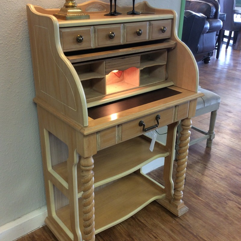 "Sweeeet.... This petite roll top desk is by National Mt. Airy and is constructed of blonde oak. It features 2 drawers with dovetail jointing, cubby spaces, 2 barley twist front legs, a pull-out writing surface and a tiny interior light. The bottom of the desk has 2-tier shelving. So, although a ""mini"" it is mighty! And of course, it has a roll top! It is the perfect desk with a big personality for a space-challenged room. It's in great condition too."