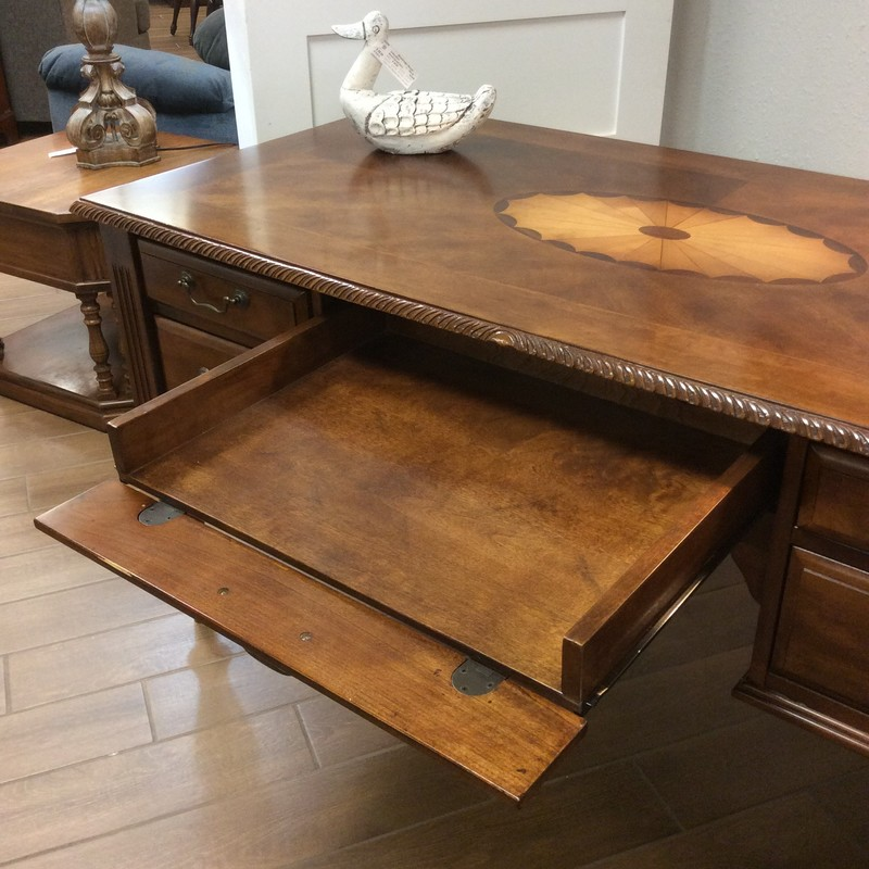 This desk by Ashley is gorgeous and in near perfect condition! This home office desk blends stately traditional style with a European old world flair, a drop-down keyboard tray and 4 drawers.