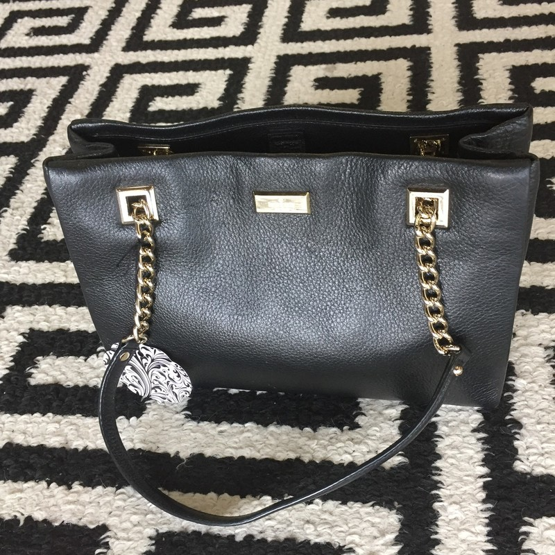 Kate Spade Phoebe bag with all leather shell exterior and a polyester interior. Medium sized handbag with four interior pockets. There are no signs of use or markings. PERFECT CONDITION! Retail: $348