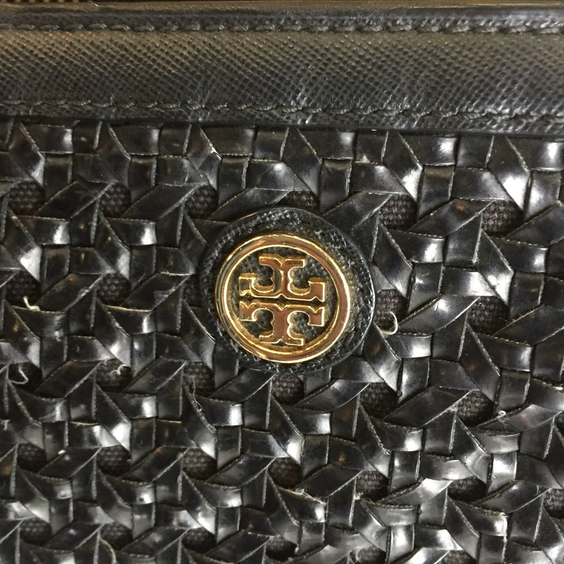 Tory Burch black woven tote made of leather with gold hardware. Exterior is in pretty good condition. Interior is lined with polyester and has little signs of use. Includes four interior pockets and has lots of room! Retail: $620 Don't miss this!!!