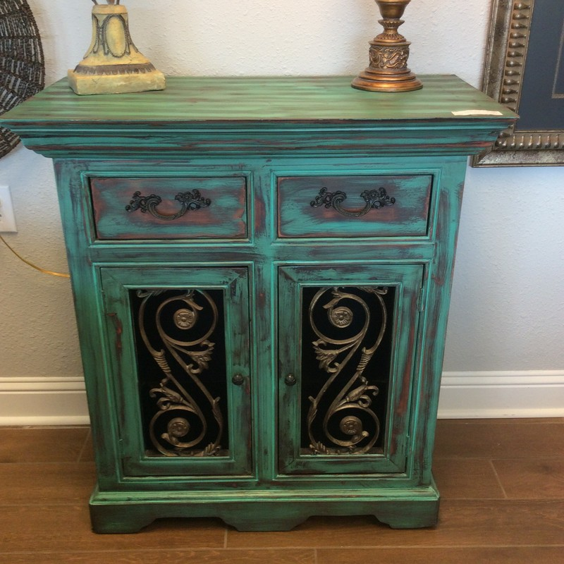 This is a really pretty little cabinet. It is solid wood with a distressed, painted finish. There are 2 small drawers up to and a roomy cupboard below. This would be the perfect size for a bathroom or an entryway!