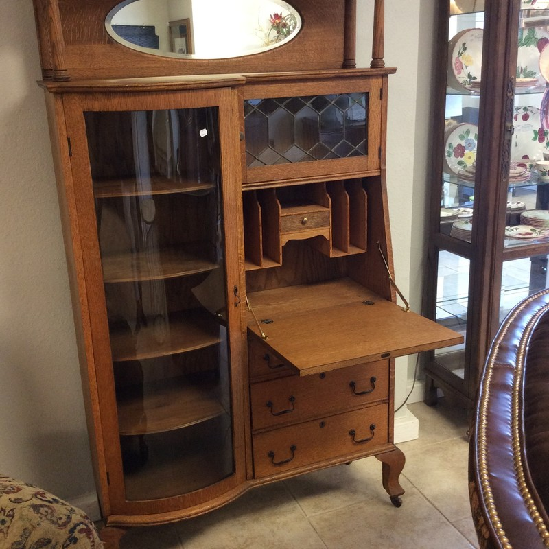 This ANTIQUE piece doubles as both a curio cabinet and a desk. How clever is that?!? The left side is the curio, and has 4 adjustable shelves with a lovely curved glass door. The right side hides the secretary desk, and also has 3 drawers and a small cabinet with a leaded glass door.