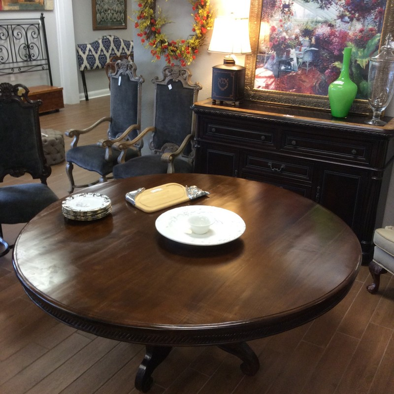 "This pedestal table is gorgeous! Simple and elegant, it's large at 70"" in diameter and features a rich, dark wood finish. The pedestal base is equally lovely without being overdone. Come by and take a look! A steal at only $800!"