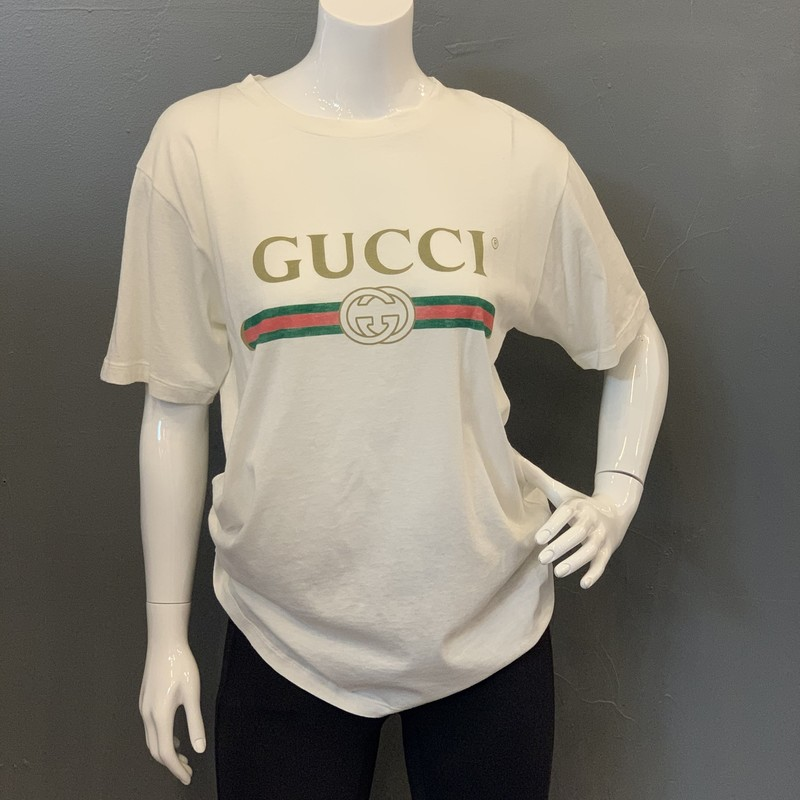 Gucci 2019 Logo Tee, White, Size: XS<br /> <br /> originally from 2017 Runway, this design is currently available in stores + online<br /> <br /> - oversized style<br /> - intentional distressing around neckline<br /> - embroidered applique flower on back<br /> <br /> current retail: $590<br /> <br /> 100% Cotton