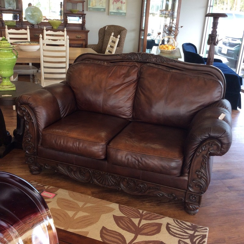 PRICE REDUCTION!!! This handsome carved wood and leather ASHLEY loveseat was just reduced from $995 to $795. Hurry in and check it out, 'cause it won't be here for long!