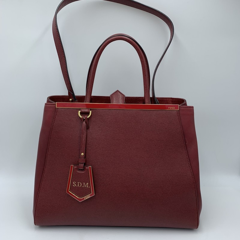 "Fendi 2Jours Tote, Red, Size: M<br /> <br /> condition: VERY GOOD. Small scratch on bottom<br /> detachable ID tag monogramed ""S.D.M.""<br /> dustbag included<br /> <br /> 13.5""W x 11""H x 6.5""D<br /> 5.5"" handle drop<br /> 13.75"" strap drop<br /> <br /> Original Retail: $2350<br /> <br /> We guarantee the authenticity of every bag on our site. Each bag comes with either an original sales receipt or a Certificate of Authenticity from AuthenticateFirst.com. Established in 2013, AuthenticateFirst.com<br /> (http://authenticatefirst.com) is one of the premier authentication services in the US, providing authentications of designer handbags, wallets, small leather goods, footwear, jewelry, and accessories. They employee in-house experts who have decades of experience working with hundreds of luxury brands."