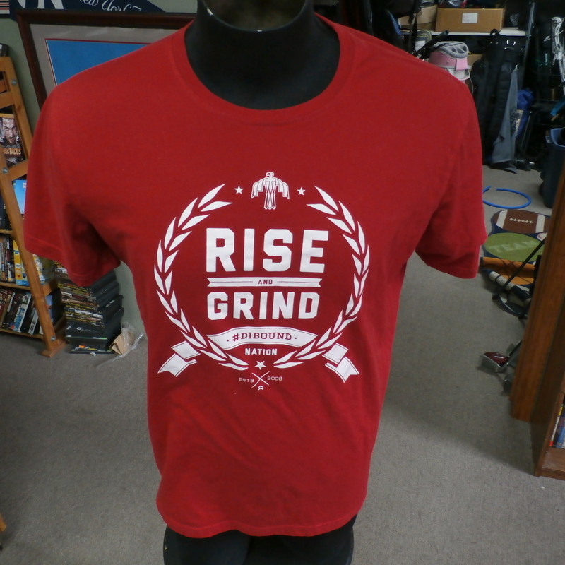"D1BOUND red ""Rise And Grind"" shirt size men's Large #35734<br /> Rating: (see below) 4- Fair Condition<br /> Team: n/a<br /> Player: n/a<br /> Brand: D1Bound<br /> Size: Men's Large- (Measured Flat: Across chest 21""; Length 27"")<br /> Measured Flat: underarm to underarm; top of shoulder to bottom hem<br /> Color: red<br /> Style: short sleeve; screen printed<br /> Material: tag missing<br /> Condition: 4- Fair Condition: minor wear from use and washing; heavy deodorant stains in armpits (see photos)<br /> Item #: 35734<br /> Shipping: FREE"