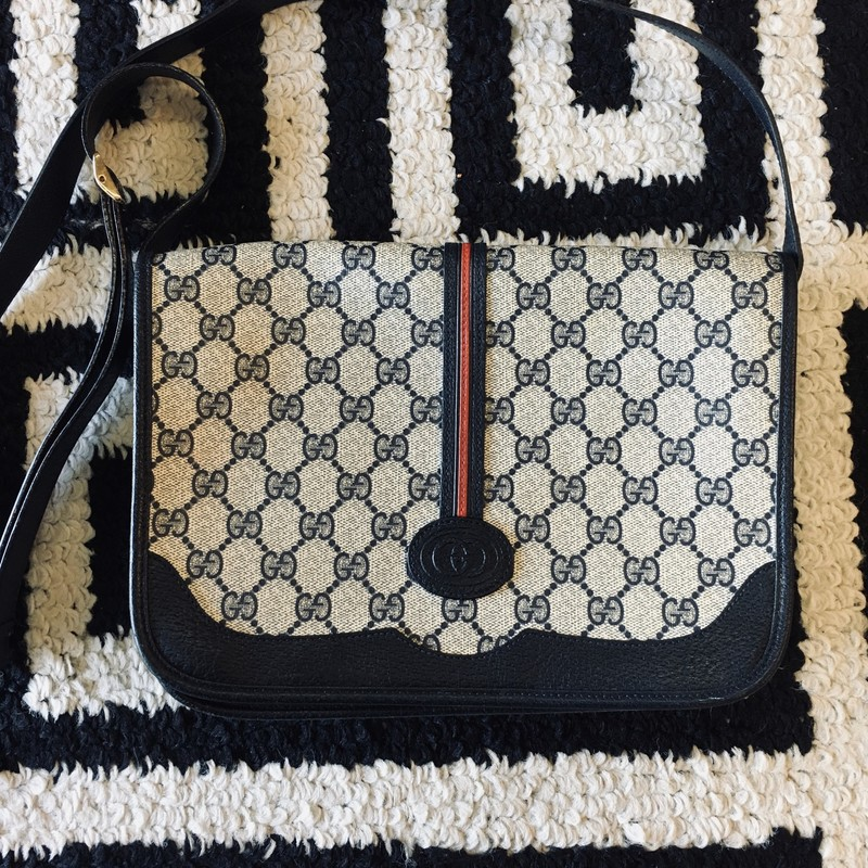 VINTAGE Gucci crossbody. Navy and tan leather monogram with navy detailing and red and blue navy stripe. Adjustable strap. Almost perfect condition, one small exterior scuff. Retail approx: $1,600