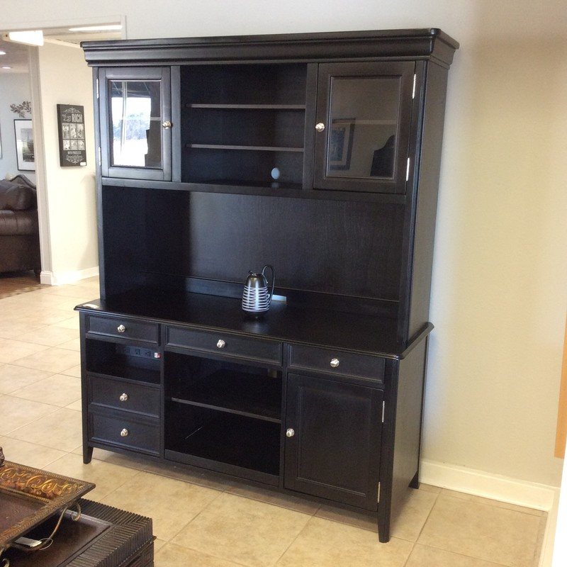 This credenza and hutch by Ashley Furniture is beautiful and functional!  It features all of the necessary elements to keep you organized. Painted a sleek, jet black  it is modern and contemporary in design, not a square inch is wasted. There is adjustable shelving, glass-front cabinet doors, several drawers, a  pull out drawer for a  keyboard, a filing cabinet and a built-in surge strip. It's in excellent condition. Come by and take a look!