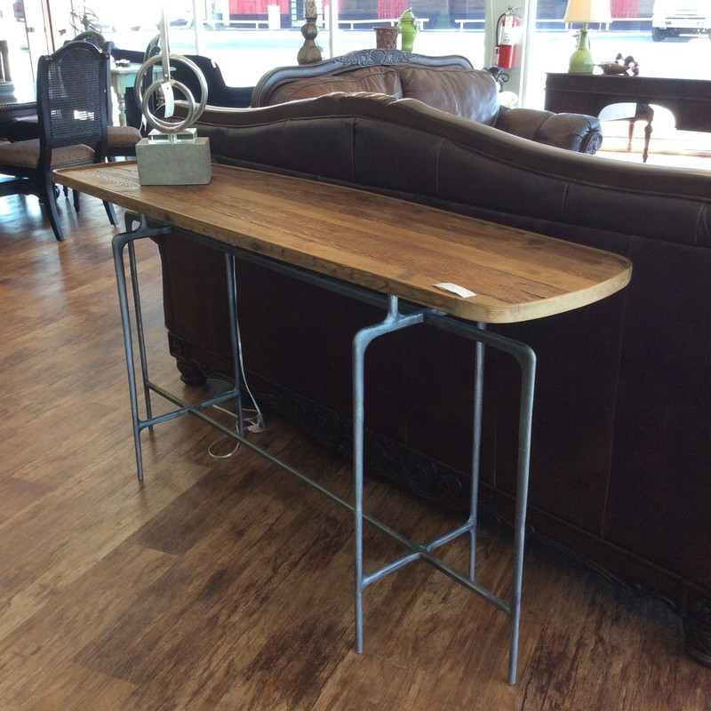 Nothing says cool like this sofa table! A hip combination of metal and wood the tabletop actually resembles a surfboard. Come by soon and take a look while it's here!