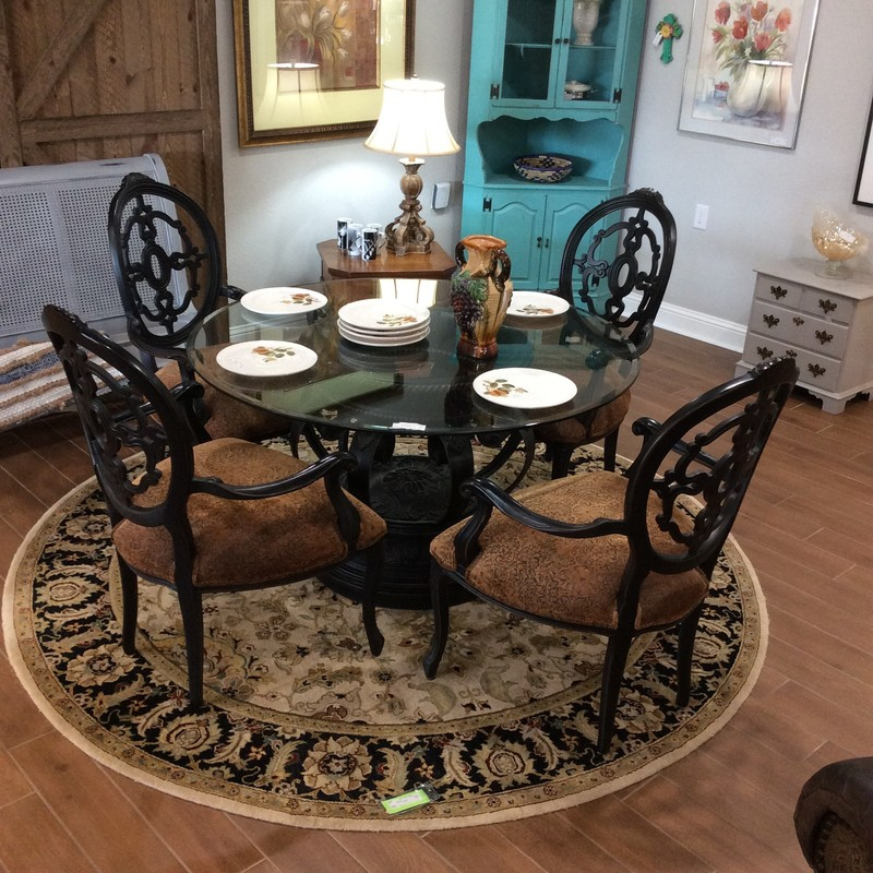 This dining room set is full of personality and charm! A lovely combination of metal, wood and glass it draws the eye. The tabletop is glass, the chairs are upholstered, roomy and comfortable. The best feature of this set, however, is the pedestal base of the table. It's magnificent! Large, ornate and antiqued it has a French sensitivity. Come by and take a look!