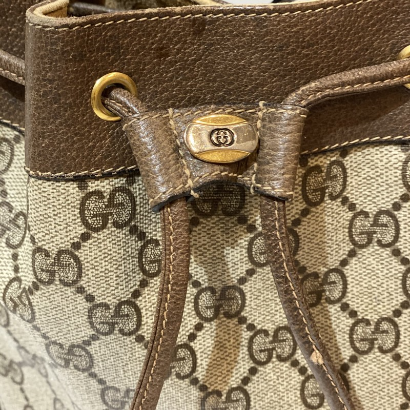 Vintage Gucci Bucket Bag, Brown, Size: Medium<br /> The bag is very old and has signs of wear. Some peeling on the inside, and seperation on the strap.