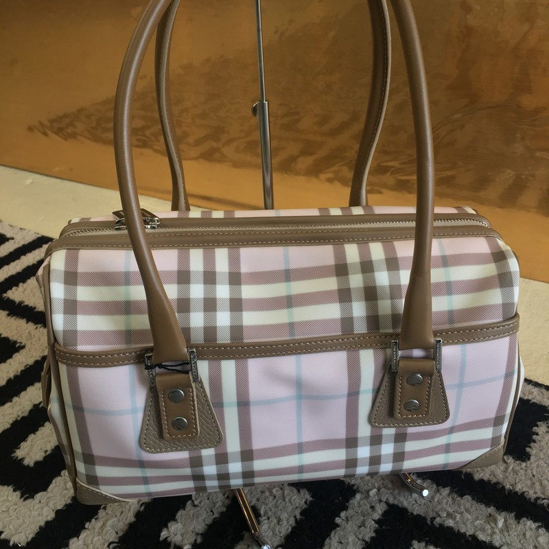 BRAND NEW Burberry shouldber bag. Pink, tan, and white PVC with tan leather detailing and silver hardware. Has outside pocket. No signs of use. Zero tears, scuffs, or ink staining. Includes duster bag. Retail: $799. WON'T LAST LONG!