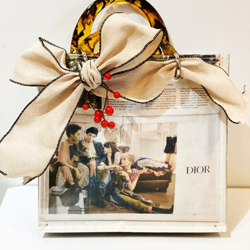 Dior Boho Newspaper Ad, New, Size: Large<br /> Brand new handbag made from 100% post consumer newspaper. Tortoise shell handles