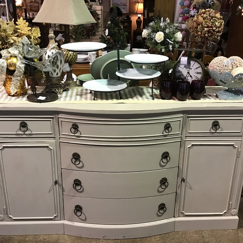 "Are you looking for a statement piece for your dining room, family room or kitchen? Look no further than this GORGEOUS server that has been updated with Country Chic's Soiree (cross between a cream and gray) and clear waxed. It has 6 drawers (one of them would be great for silverware) and 2 cabinet doors (interior shelf in each). It has been painted by one of our local artists, distressed and then waxed for durability. Great piece to use as a server or media stand!<br /> Dimensions are 62"" x 21"" x 34"""