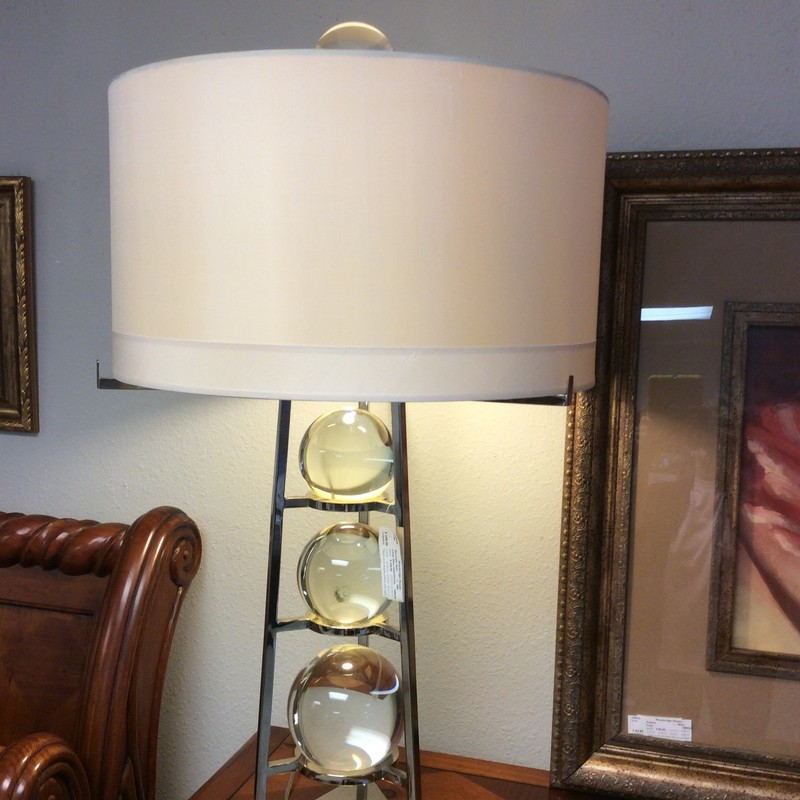 "This is one very cool lamp!! Ultra contemporary,  it is a beautiful combination of glass and chrome. The glass orbs sparkle and shine, 2 of them sit in their chrome bases and are removable. The chrome base is sleek and linear resulting in 39"" of silvery height. Topped off with a rather conservative and traditional beige shade. It's a beauty!"