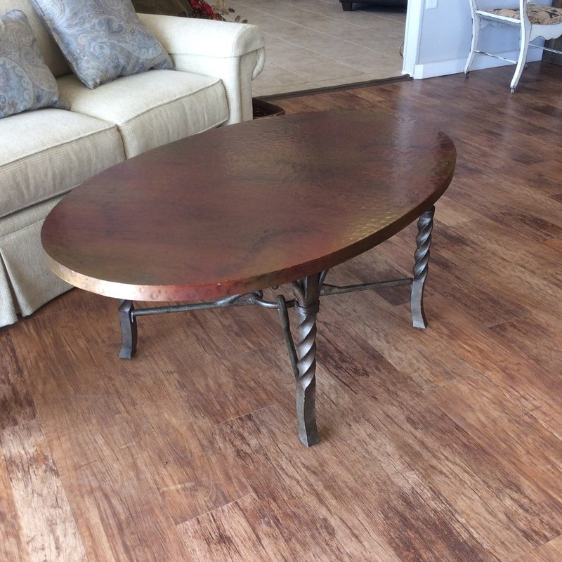 This is a really cute little coffee table. It has a scolled metal base with a burnished finish. The oval top is solid wood, and completely covered in a single piece of hammered copper. Only $245!
