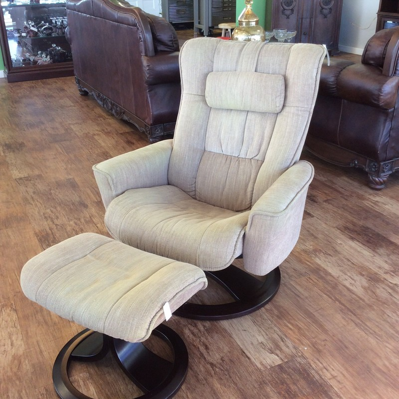 Bargain Alert! This upholstered chair swivels and reclines. It's upholstered in a soft gold cotton blend and comes with a matching ottoman. Come by and take a look! Super comfy!