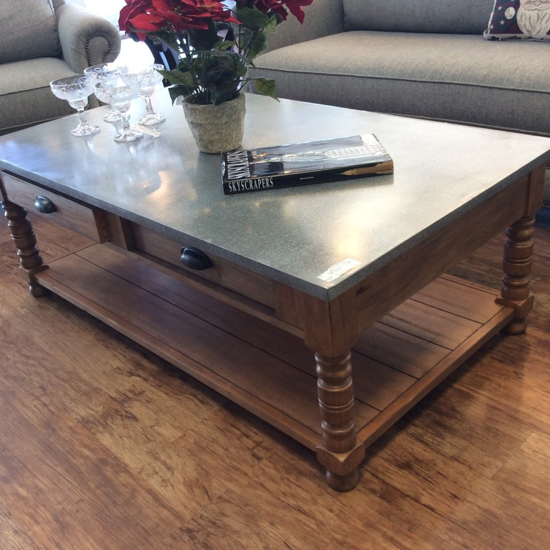 This smart looking MAGNOLIA HOUSE table really was originally from WACO. The base features solid wood construction with a pretty maple finish. The top is also solid wood, but it is covered in a sheet of ZINC, giving it a farm-housy look. The 2 drawers push all the way through the other side of the table.