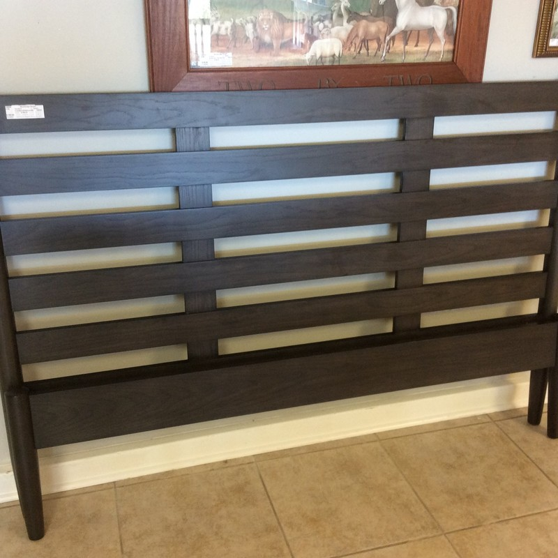 This is a pretty CRATE & BARREL Queen sized platform bed. In fact, all you need is your mattress - no box spring required! It appears to be solid wood, and has black and brown finish.