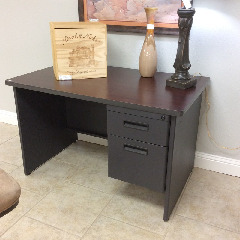 Bargain Alert!  Need a reliable, attractive desk without spending alot of moola? At $195. this could be it!  It's in  good condition and features a drawer and a filing cabnet. Constructed of a dark, slate gray metal with a faux wood laminate desk top. It's also a great size for a smaller space, not too big. Sleek and minimalistic.