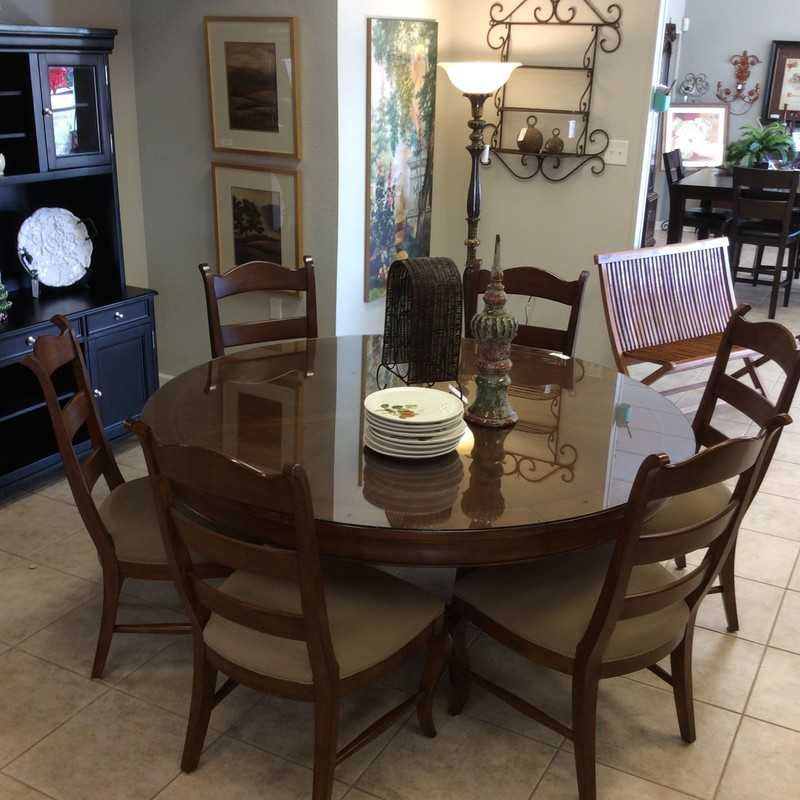 "This dining room table by Hooker is gorgeous, wouldn't it be perfect for your holiday gatherings? 68"" in  diameter it features a rich, dark wood finish and a glass top. It includes 6 upholstered ladderback chairs. Very good condition!"