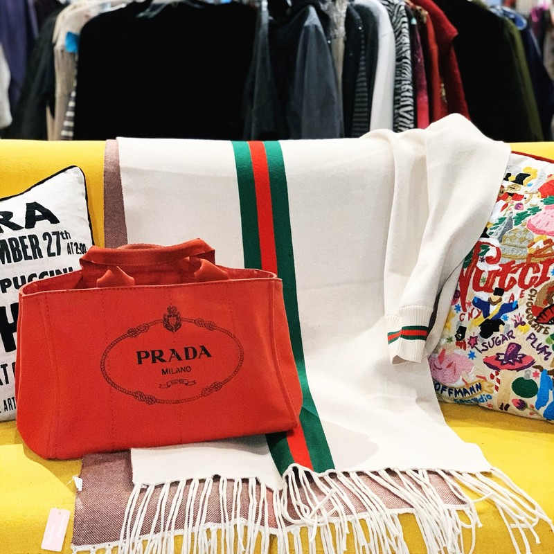 "Prada Canvas Logo Tote, Red, Size: Large<br /> Red canvas Prada tote with gold-tone hardware, dual flat top handles, logo print at front, tonal canvas interior, three interior pockets; one with zip closure, and open top. Handle Drop: 6""<br /> Height: 10""<br /> Width: 16""<br /> Depth: 10""<br /> Tote in good condition but has gently worn signs of use. A fabulous Tote!"
