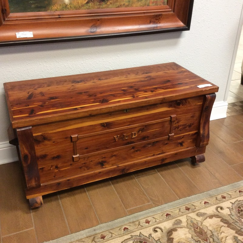 This is a darling little cedar chest. It features solid cedar construction, and the outside is finished, while the inside is not. Inside there is a sliding tray at the top, and  plenty of roomy storage below. The initials on the front, VLD, can be easily removed, too.