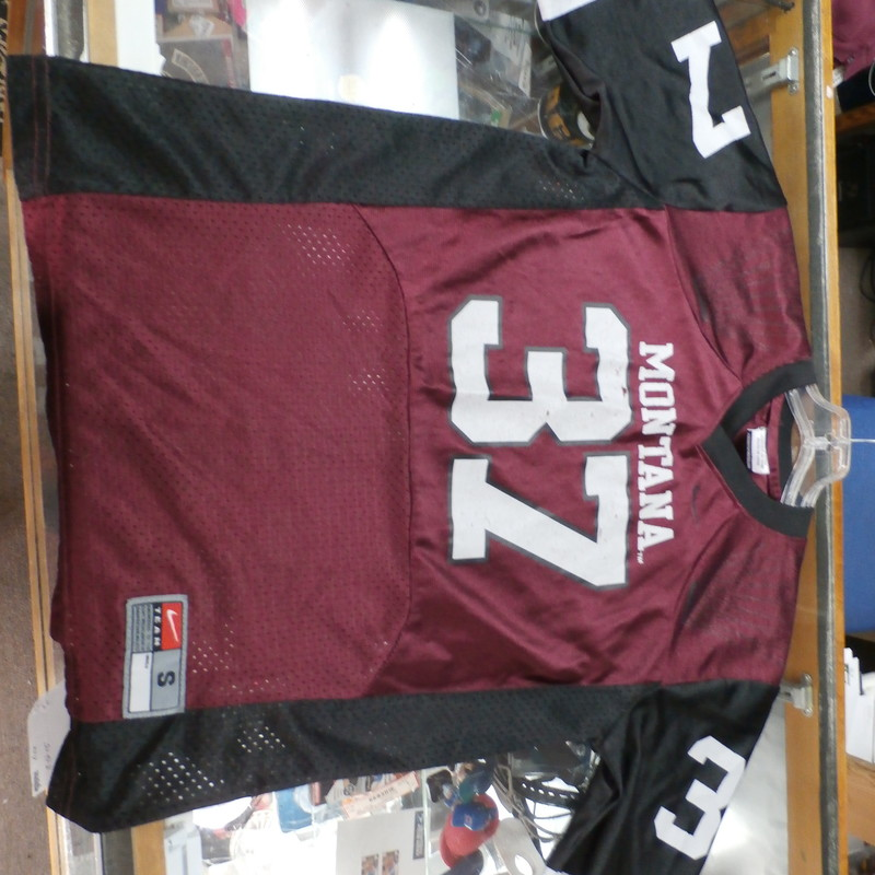 "Montana Grizzlies YOUTH Nike jersey maroon size Small 8/10 polyester #36353<br /> Rating: (see below) 4- Fair Condition<br /> Team: Montana Grizzlies<br /> Player: n/a<br /> Brand: Nike<br /> Size: YOUTH Small 8/10- (Measured Flat: Across chest 17""; Length 22"")<br /> Measured Flat: underarm to underarm; top of shoulder to bottom hem<br /> Color: maroon<br /> Style: short sleeve; screen printed<br /> Material: 100% polyester<br /> Condition: 4- Fair Condition: some wear and snags from use; screen printing is cracked and peeling (see photos)<br /> Item #: 36353<br /> Shipping: FREE"