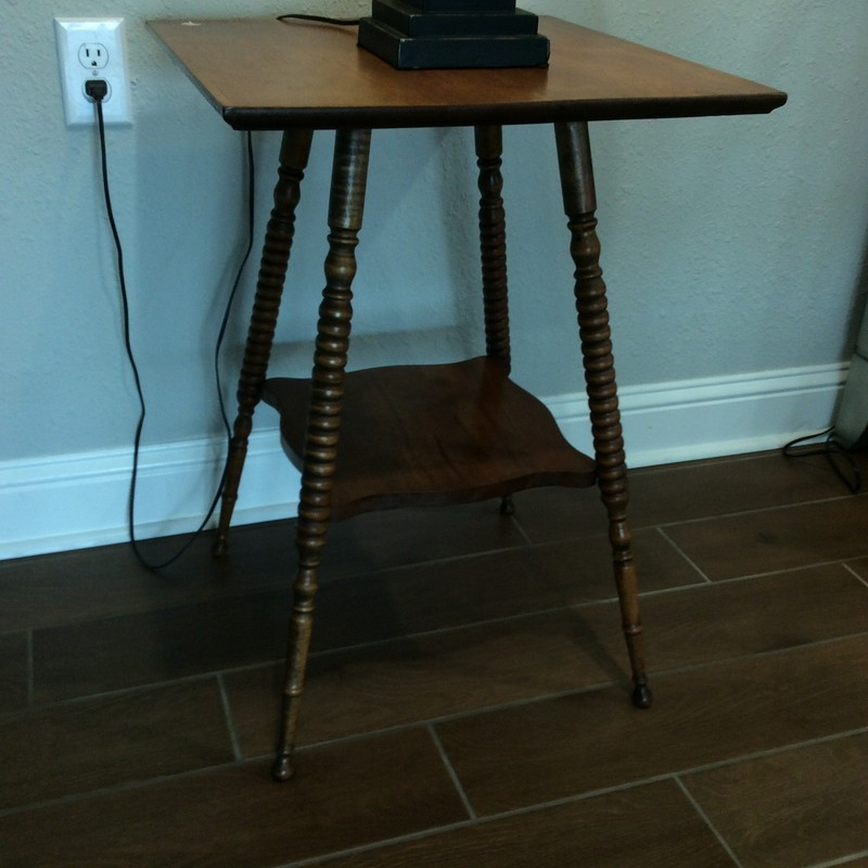 "This adorable little table is at least 100 years old. It is solid wood with a walnut finish and features hand carved spindle legs, as well as a lower shelf. It is the perfect size, too, with a 20"" square top and a heighth of 28"". Only $125!"