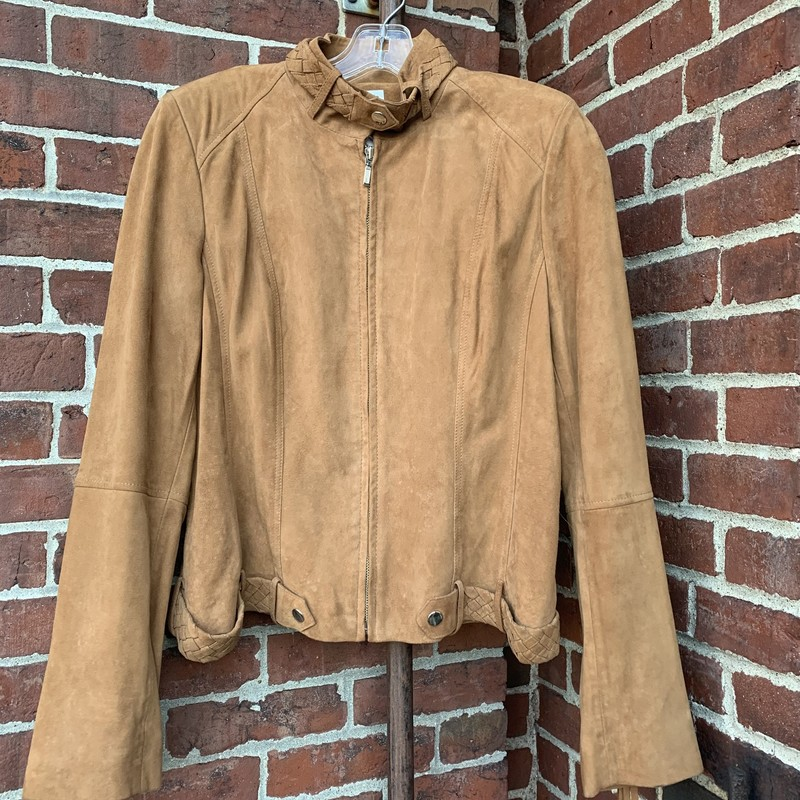 Jacket is in good condition. Made from goat suede, this fun fringe jacket will keep you warm and stylish. Size 10.